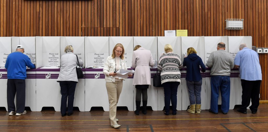 Voters cast their ballots in the seat of Lindsay, for Federal Election in Sydney, Saturday, July 2, 2016. (AAP Image/Paul Miller) NO ARCHIVING